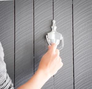 Using a door knocker to knock on a door